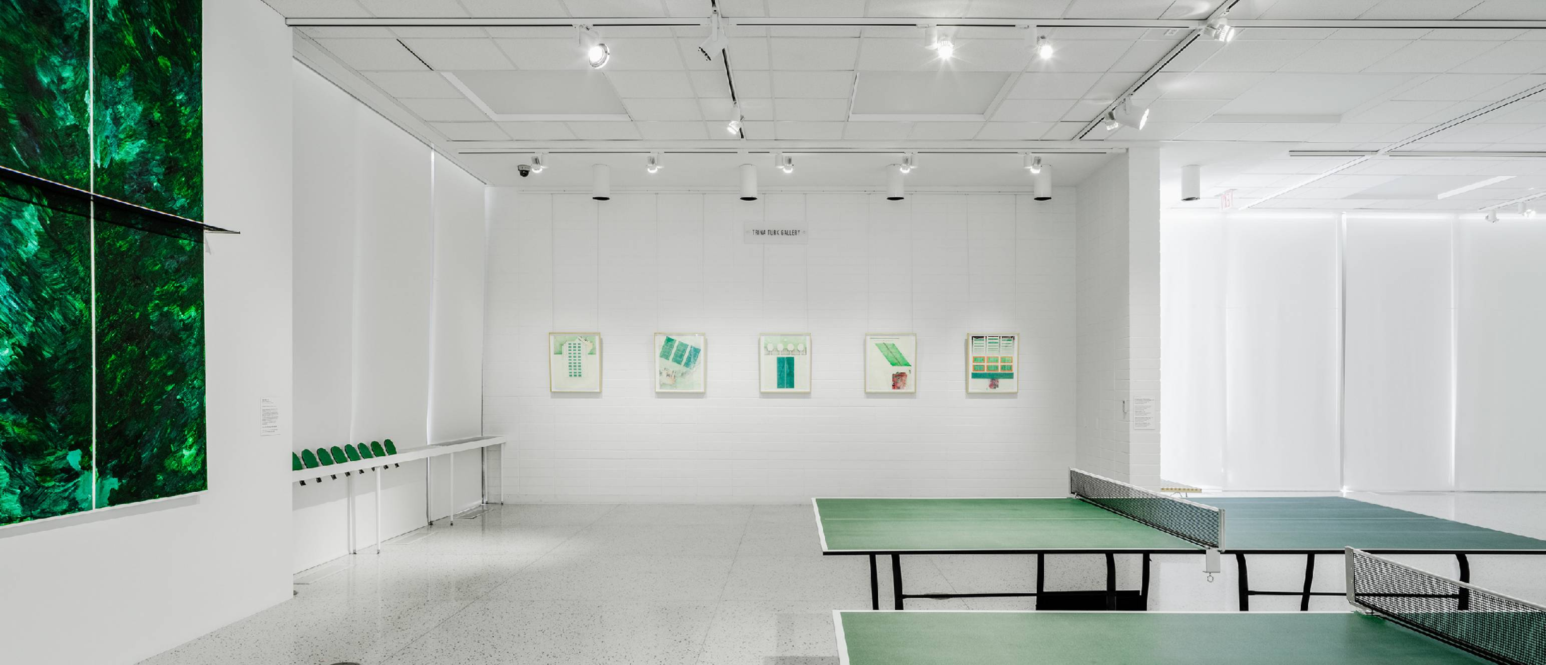 Ping pong tables, drawings and artworks in the gallery