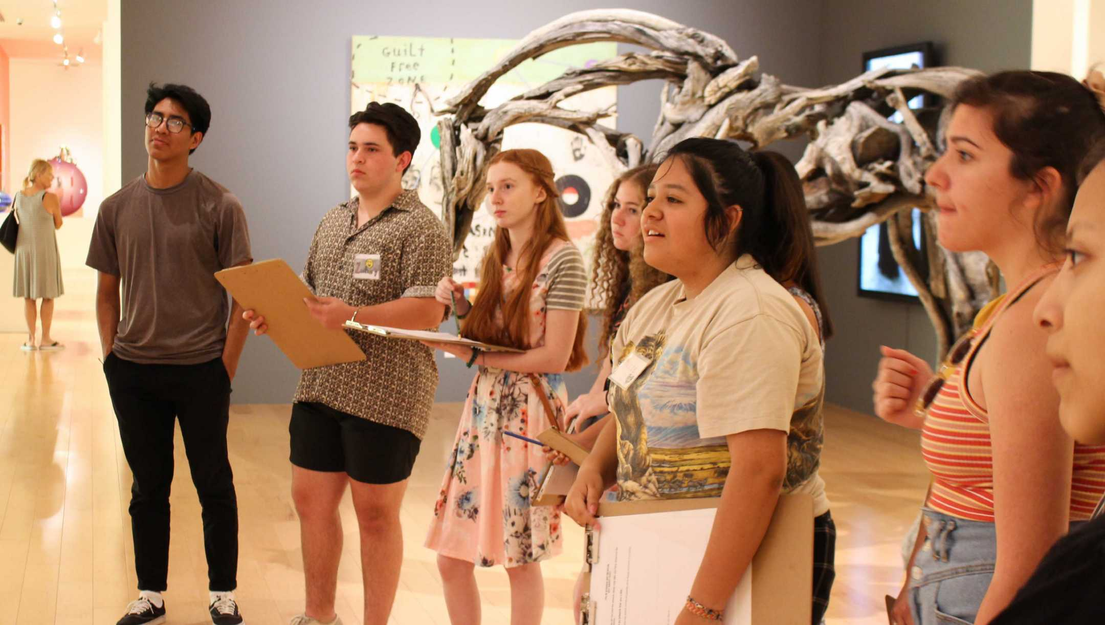 teens learning about art in a gallery