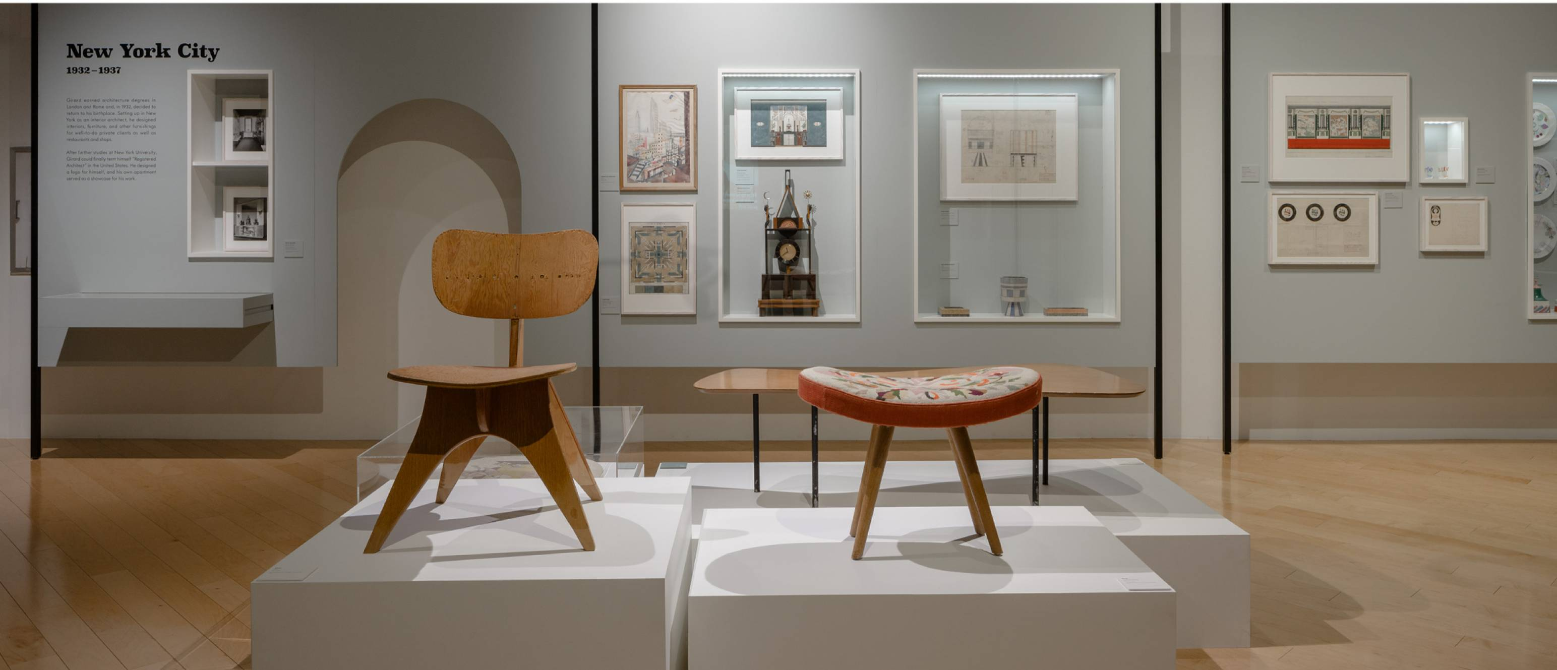 Alexander Girard exhibition, Prototype chairs and artworks in the back