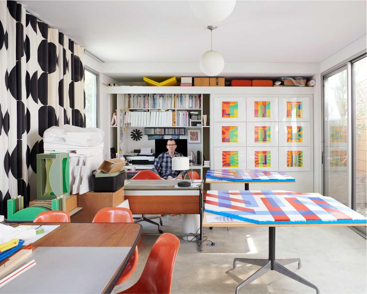 Jim Isermann sitting in his studio