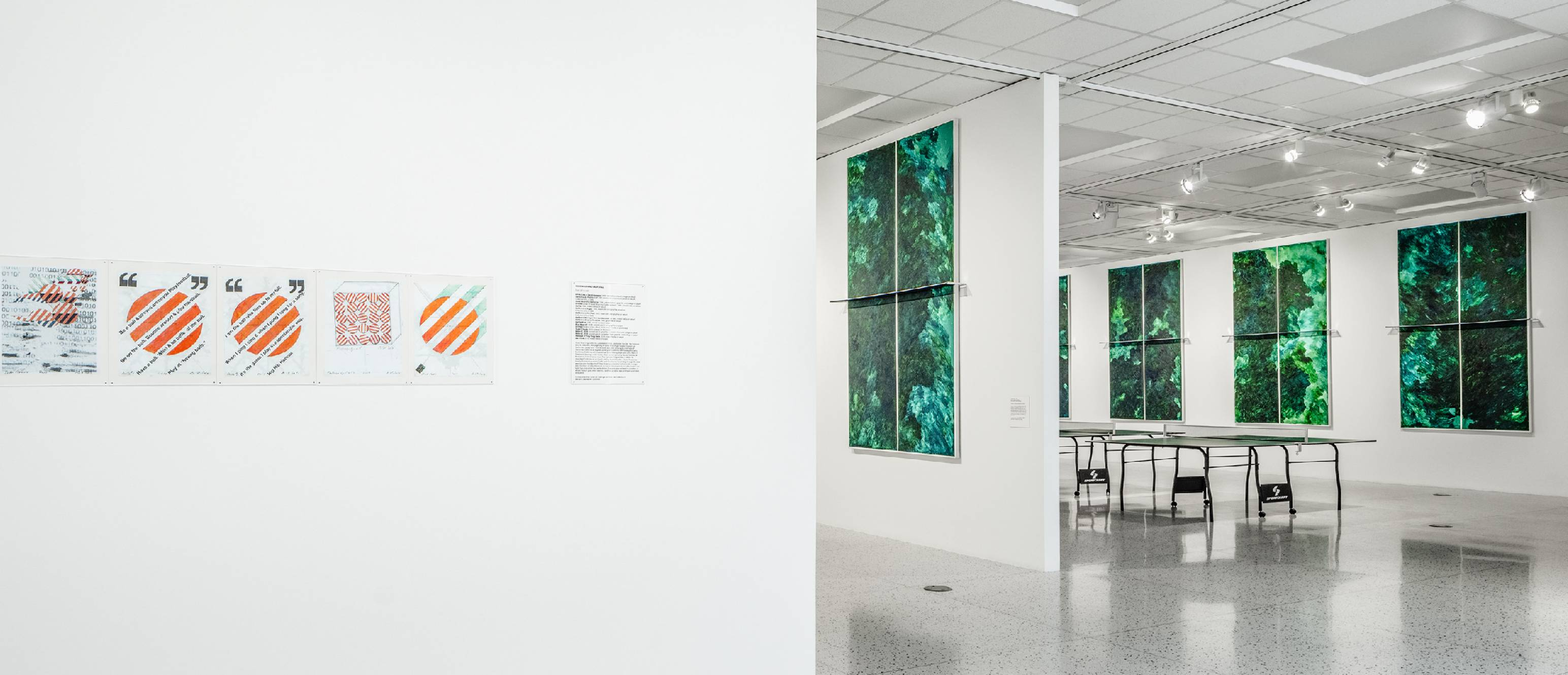 Drawings and painted ping pong tables on the walls of the gallery